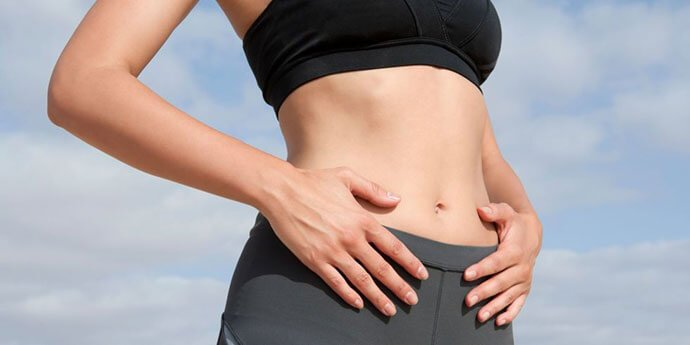 Belly massage to reduce weight with ginger wine